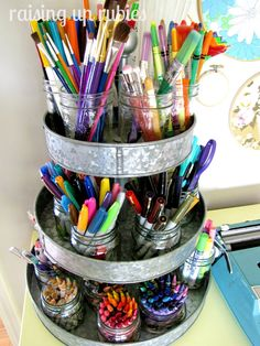 Crafting markers, pencils, pens, crayons, scissors, etc storage.... If you put on a lazy Susan, it would make all sides easily accessible....