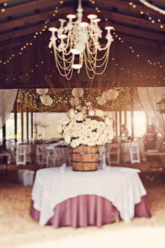 Gorgeous rustic wedding with oak barrel and chandelier