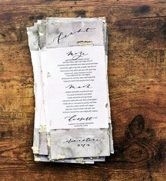 These beautiful menus are printed on 140 lb. cold-press watercolor paper, hand-torn, dipped in ink or watercolor and accented with bits of shiny