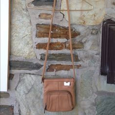 Tignanello tan crossbody bag- like new Tignanello tan crossbody bag- like new. Real leather. Strap length is about 50 and is not adjustable Tignanello Bags Crossbody Bags