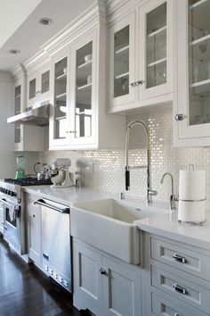 Lovely mix of traditional cabinetry and styling and contempo faucet.
