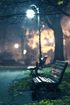 A bench under a street light