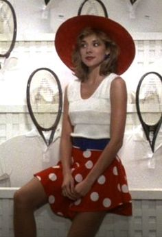 Kim Cattrall's 50's polka dots in Mannequin. The dress is cute ... but I love the tennis raquets!