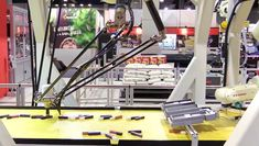 This high speed pick and place Kawasaki robot is interfaced with a plug and play modular conveyor system custom built by SmartMove®. The conveyor runs on 110 vac, using less than 3 amps. Modular qualities allow for reconfiguration of conveyor units to be longer or shorter. #conveyors #modularconveyors #roboticconveyors #conveyorsystems Conveyor System, Treadmill, Robot, Gym Equipment, Treadmills, Workout Equipment, Robots