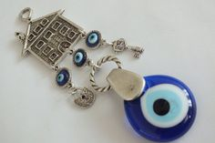 Evil eye wall hanging with hause Silver Plated  by EvilEyeHome