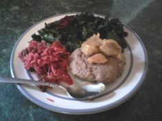 bison burger topped with garlic aioli. fermented red cabbage and sauteed greens