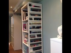 DIY nail polish storage attached to a bookcase, beautiful and doesn't take up wall space! Add a small lip to each shelf to make it more earthquake friendly