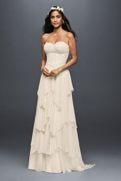 You will float down the aisle in this A-line gown\'s beautiful layers and layers of weightless chiffon. The strapless sweetheart bodice is crafted of corded lace and sprinkled with sequins.  Melissa S