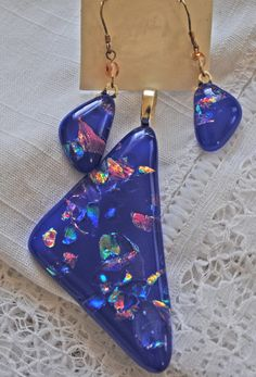 Indigo Dichroic Triangle Pendant and Matching by LynnieBirdJewelry, $35.00 on etsy. I love the earrings, especially. Handmade glass jewelry!