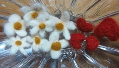 Handmade flowers and 'love u' hearts.  http://www.etsy.com/listing/97302538/hearts-and-flowers-needle-felted