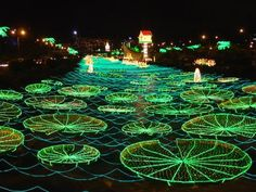 Christmas lights in Medellin, Colombia. My family and I would go to this river every Christmas for the floating light show <3
