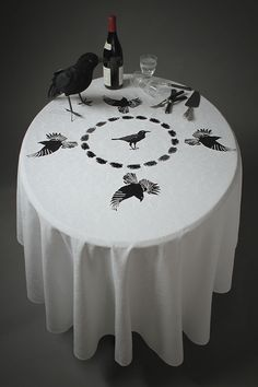 Upcycled circular damask tablecloth embroidered with raven, crows and feathers. www.etsy.com/shop/brillandben