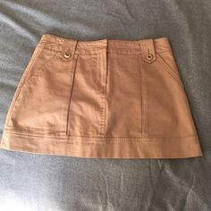 Trina Turk Khaki Skirt Donating soon!!!!!! Barely Worn!! Trini Turk size 4. True to size. Brown Khaki. Front pockets. Hardly worn-just too big on me now. Trina Turk Skirts Mini