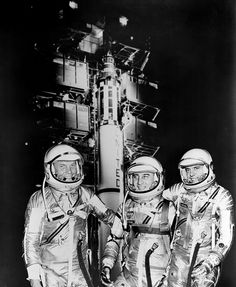 1961 -- The first three Americans in space, Mercury astronauts, from the left, John H. Glenn Jr., Virgil I. (Gus) Grissom and Alan B. Shepard Jr. standing by Redstone rocket in their spacesuits.   Photo credit: NASA