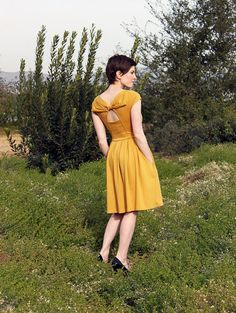 HOLLY GOLIGHTLY in MUSTARD  Muted yellow dress by FleetCollection, $68.00