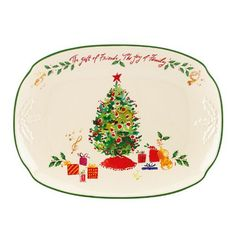 """This lovely Lenox Holiday Illustrations platter is a perfect serving piece for your holiday table. On the platter, the words """"The gift of friends, The joy of family"""" are an inspiration and in the center of the platter is the image of a decorated Christmas Tree. Crafted of ivory porcelain, this generously sized platter will become a treasured family keepsake. Length: 14""""."""