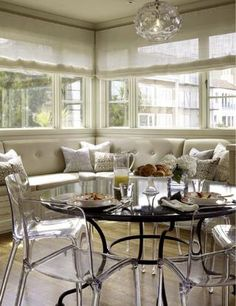 The tufted banquette paired with ghost chairs around the metal table...love  via House of Fifty Magazine
