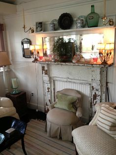 antiques and antiques = perfect!  (have a white fireplace mantle like this....just needs a little roughin' up!)