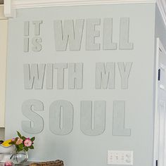 Hang canvas letters on the wall - plus TONS of other creative, budget-friendly feature wall ideas!
