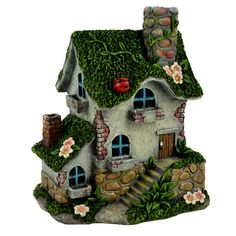 Dress up your fairy garden with the cozy cottage design of this decoration that creates character in a flower bed or near a rock wall. W x H x DPolyresin / stone powderImported Clay Fairy House, Gnome House, Fairy Garden Houses, Miniature Fairy Gardens, Miniature Houses, Bristol Houses, Clay Fairies, Clay Houses, Cottage Homes