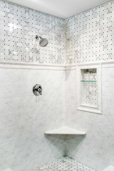 This polished white marble tile livens up the walls and floors in your bathroom baths showers with a distinctive basket weave design - Hampton Delray Marble Mosaic Tiles https://www.tileshop.com/product/657370-P.do