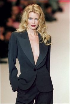 Le smoking par YSL Modeled by Claudia Schieffer, who can transform herself from a mildly pretty, very blonde woman into a smoking-hot bombshell.