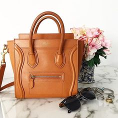 83cb8c1da92c The Ultimate eBay Shopping Guide by popular New York blogger Covering the  Bases Prada Handbags