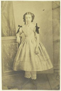 Little girl by Edward Isaak Asser, 1850's. Adding black ribbon bows to a white dress was typical mourning attire for young girls,