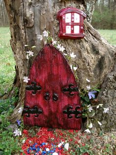 Fairy Door Set - consisting of Large Dragon Door and Dragon Window  -Dark Reds & Black - Die Stone Cast. (FRB). $36.99, via Etsy.