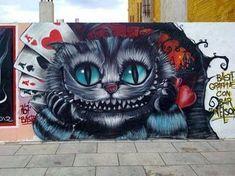 chat de chestershire alice au pays des merveilles street art