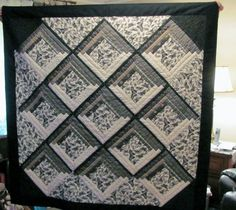 """Black White Butterfly """"I made this lap quilt for my oldest son and his wife; this is the colour scheme in their house. The butterfly print fabric I bought at Hobby Lobby, but the dark strips around those are all cut from men's shirts bought at Goodwill."""""""