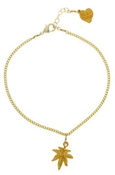 "Adjustable 18kt gold plated chain anklet featuring a single gold leaf charm. By Vidakush 10"" Long 0.75"" Pendant length - Imported"