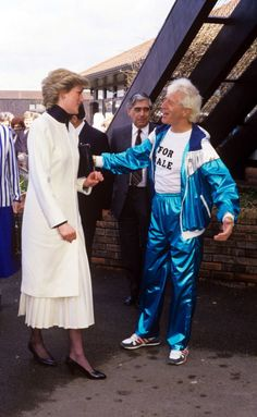 March 30, 1987: Princess Diana with Jimmy Saville during a visit to Stoke Mandeville Hospital.