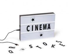 This Better Living light box is a replica of the movie theater billboards from back in the day. Made of plastic, the light box includes a set of different letters and symbols for you to come up with your own inspiring movie title. Built-in LED lights will Holiday Gift Guide, Holiday Gifts, Inspirational Movies, Kitchen Store, Home And Living, Decorative Items, Cinema, Clock, Box