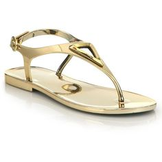 Stuart Weitzman Trifecta Metallic Jelly Thong Sandals ($235) ❤ liked on Polyvore featuring shoes, sandals, apparel & accessories, gold, toe thongs, flat thong sandals, thong sandals, cutout sandals and cut out sandals