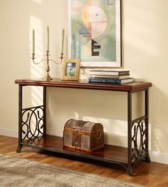 Enhance your home decor with this scrolled metal and wood sofa table Elegant accent table features detailed metal scrolls on long sides of table Sturdy table is supported by a fashionable metal frame and legs
