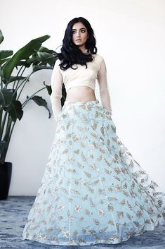 Gorgeous light blue net lehenga skirt with white crop top from Poppy Lane. Click on image to see price. #Frugal2Fab