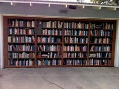 Photo by author Robert Crais of a garage door in LA painted to look like book shelves.