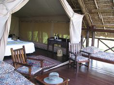 Finch Hatton's Safari Camp,  Tsavo West National Park (Kenya).  'Dress for dinner and eat from  bone china deep in the African  wilds.' http://www.lonelyplanet.com/kenya
