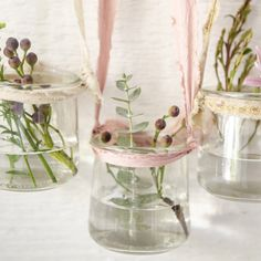 Recycled Yogurt Containers Hanging Wall Decor | Stampington & Company Glass Containers, Glass Jars, Flower Holder, Recycled Crafts, Tree Branches, Yogurt, Christening, Craft Supplies, Upcycle