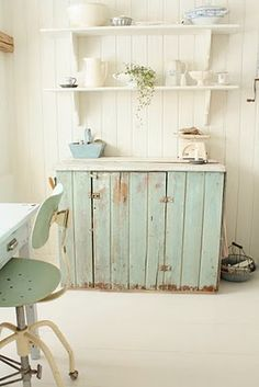 rustic buffet cupboard with shelves on wall brackets and vintage stool