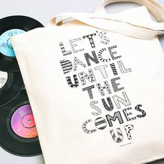 'Let's Dance Until the Sun Comes Up' is a fantastic typographic illustration by Erin McIntyre for the Artists for Alphabet Bags Collection.Our bags have mid-length straps which are ideal for being carried by hand or over the shoulder. Our bags are designed and custom made in the UK with great care by lovely ladies and gentlemen. We only use the most terrific heavy weight cotton and all designs are screen printed by hand. They are not your typical tote!The design is a perfect example of…