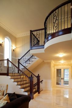 Traditional Staircase with Metal staircase, limestone tile floors, flush light