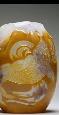 "Carp Vase designed by Eugène Rousseau and made by Appert Frères, 1878–84... Among the most innovative designers to adopt ""Japonisme,"" as the phenomenon became known, was Eugène Rousseau. Initially, he specialized in ceramics, but in the late 1870s and early 1880s, Rousseau produced designs for glass manufactured by Appert Frères in Clichy....the image of the carp in the swirling waters was taken from an ""ukiyo-e"" print in Hokusai's ""Manga,""..."