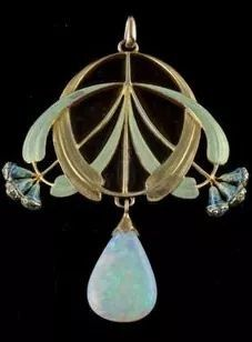 An 18 carat gold enameled pendant with a large opal drop and small diamonds in the eucalyptus buds.   Signed E. FEUILLÂTRE  (Eugene Feuillâtre, French 1879-1916)