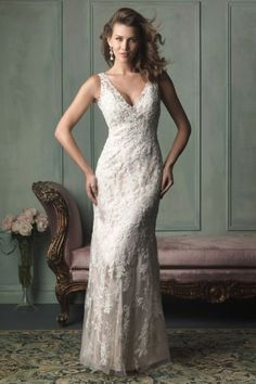 Ivybridge 9116 | Allure Bridal | Romantic lace appliqué drapes perfectly over silky charmeuse satin, highlighting a trailing overskirt. Both the neckline and back feature a deep V.     Gown available in White/Silver, Ivory/Silver, Gold/Ivory/Silver    *Pictured in Gold/Ivory/Silver    Available at GatewayBridal.com or In Store At Gateway Bridal In Salt Lake City, Utah