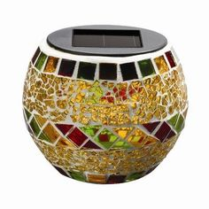 Mosaic Glass Solar Decorative Light in Autumn by Westinghouse. $8.40. 869001-YL Features: -Solar decorative light.-Amorphous panel.-Each with sticker.-1 x 350 MAH NI-CD AA battery.-Eco friendly. Construction: -Glass construction. Color/Finish: -Autumn finish.-Accommodates (1) spectrum color changing LED bulb. Dimensions: -Overall dimensions: 4.291'' W x 4.291'' D.