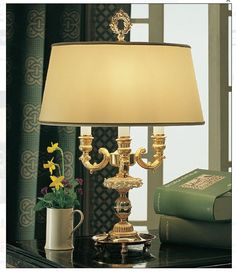 Beautiful Capo di Monte porcelain roses adorn this lovely traditional table lamp, made in Italy. It comes from one of our most luxurious ranges, and the detail is exquisite! Find out more at :  http://www.italian-lighting-centre.co.uk/traditional-metal-enamel/traditional-italian-table-lamp-with-white-porcelain-roses-p-6670.html#.VUJtW_nF9j8