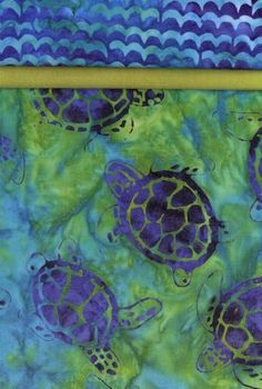 Pillowcase Kit - Turtle Bay 2. This lovely batik style pillowcase kit features turtles in blue swimming across a green ground. The accent is a matching sea green and the top is blue waves. Kit contains the fabric and pattern you need to make one pillowcase.