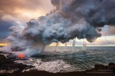 Six waterspouts form due to the intense heat from a lava flow- Kilauea Volcano, Hawaii